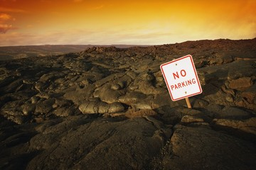 No Parking Sign On Volcanic Rock
