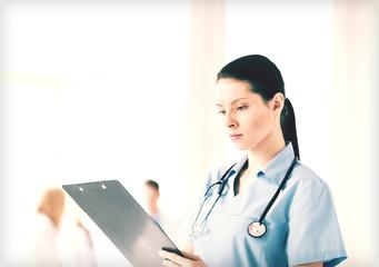 female doctor or nurse in hospital
