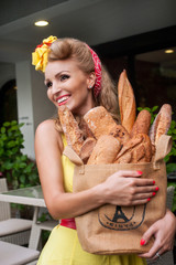 portrait of a beautiful girl with a baguettes , pin up