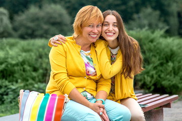 Portrait of mother with her daughter in the park