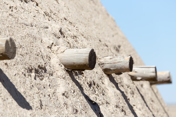 logs in the wall of the ancient city Sauran, Kazakhstan.
