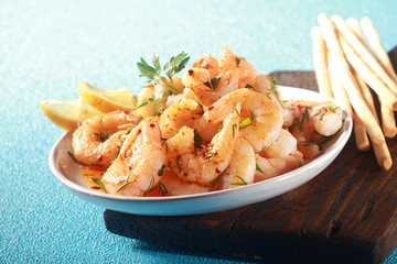 Appetizer of grilled pink prawns or shrimp