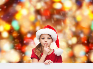 smiling little girl in santa helper hat
