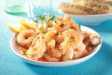 Tasty grilled shelled pink shrimps or prawns