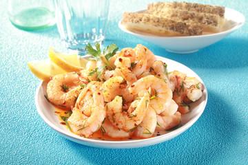 Gourmet seafood starter of grilled pink prawns