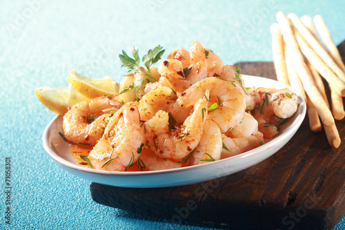 Fototapeta Appetizer of grilled pink prawns or shrimp