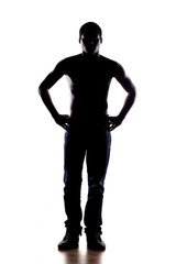 silhouette of a half-naked African man on a white background