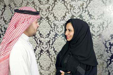 Arabian businessman talking with a woman wearing hijab