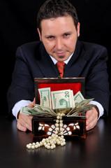 Businessman is extending gift box