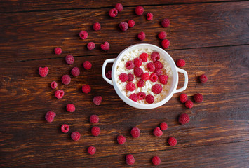 Curd with ripe raspberries