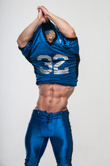 Good-looking model in american football uniform