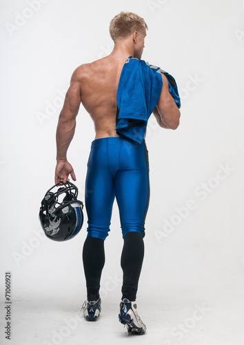 canvas print picture Good-looking model in american football uniform