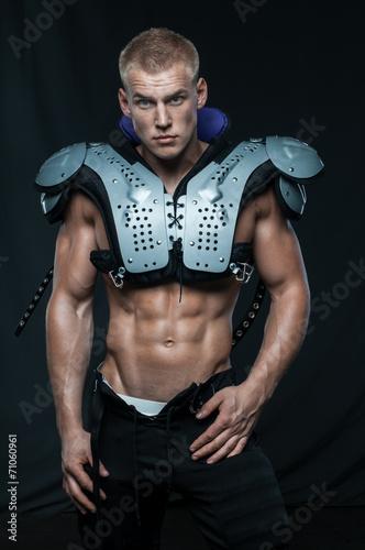 Good-looking model in american football uniform
