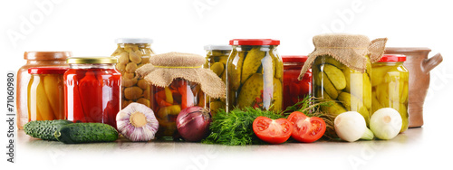 Keuken foto achterwand Verse groenten Composition with jars of pickled vegetables. Marinated food
