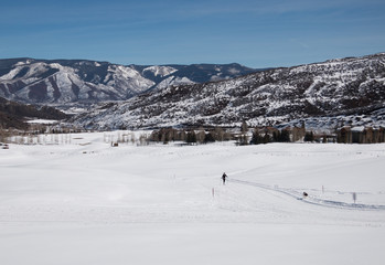 A woman cross-country skiing at valley in Utah