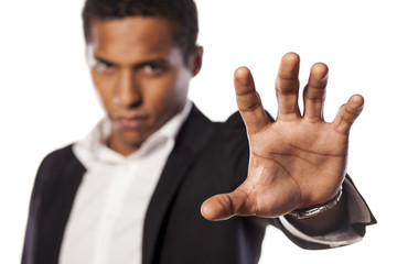 angry african guy showing stop hand