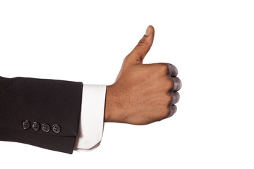 dark skinned hand in suit showing thumb up