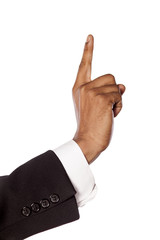 dark skinned hand in suit showing direction