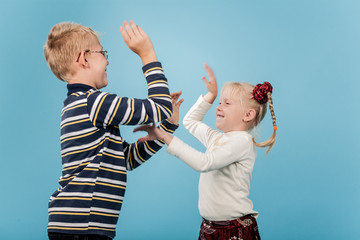 Brother and sister start a playful fight with each other