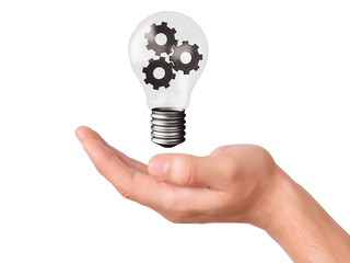 hand hold light bulb with gears. business concept