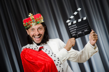 King with movie board in funny concept