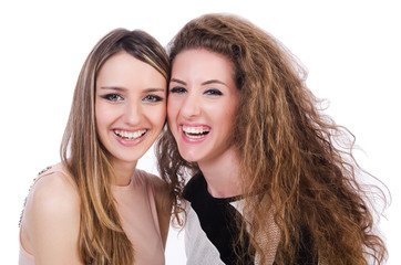 Two female friends isolated on the white