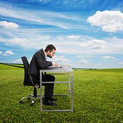 man using laptop at outdoor