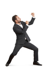 young businessman beating his fist