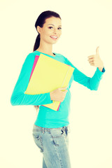 Young student woman gesturing OK