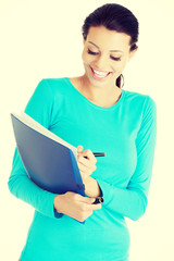 Happy student woman with notebook