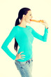 Fit young beautiful woman with carrot