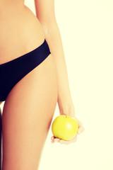 Beautiful female body and apple