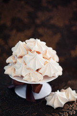 Meringue cookies on cake stand, selective focus