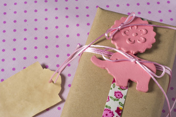Gift wrapped in recyclable paper, ribbons and label flower