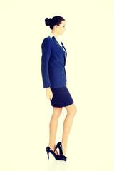 Side view of walking elegant businesswoman