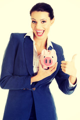 Happy excited success business woman with her savings