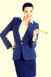 Attractive happy businesswoman with pen