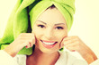 Beautiful woman with a towel on her head holding her cheeks