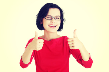 Woman in casual clothes gesturing thumbs up.