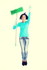 Happy cleaning woman portrait