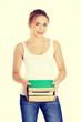 Happy teen woman holding books