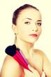 Female model holding make up brushes