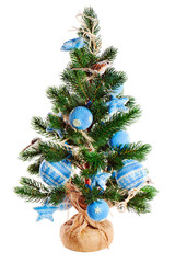 Christmas fir tree decorated with toys isolated on white backgro