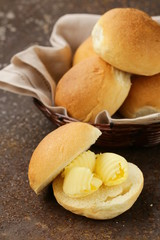 yellow dairy butter on a fresh bun bread