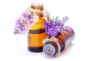 Bottles with lavender oil isolated on white background