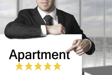 businessman pointing on sign apartment golden rating stars