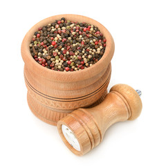 assortment of spices in wooden pot and mill