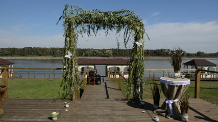 The wedding arc decorated with white butterflys