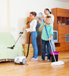 family with  cleaning equipment