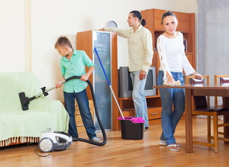 Family cleaning with vacuum cleaner